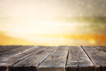wood planks in front of sea landscape  lens flare  filtered image   photo