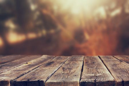 table top: wood board table in front of summer landscape with lens flare    Stock Photo