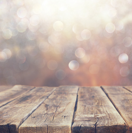 wood board table in front of summer landscape with lens flare    Stock Photo