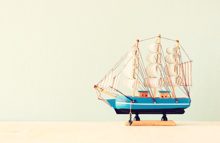 decorative boat over wooden textured background   photo