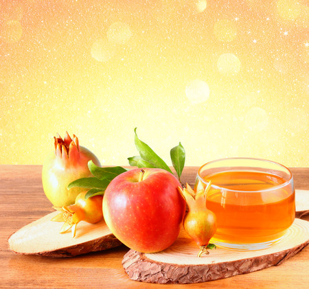 shana: rosh hashanah concept - apple honey and pomegranate over wooden table