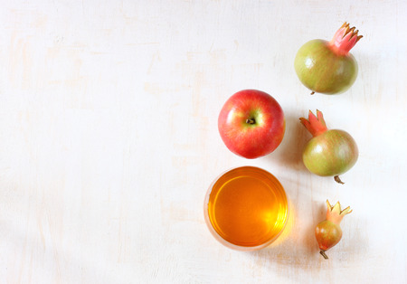 apple, honey and pomegranate symbols of rosh hashanah holiday