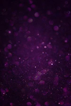 zwart zilver en paarse abstracte bokeh lichten onscherpe achtergrond
