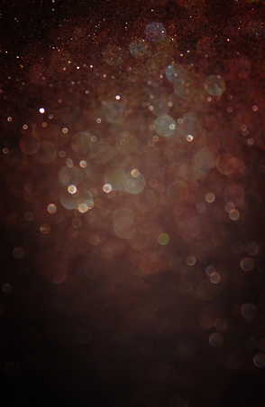 glimmer: glitter vintage lights background  light gold and black  defocused Stock Photo
