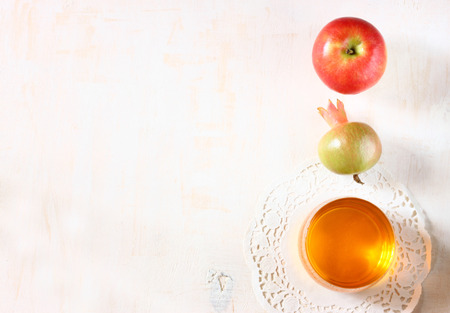 shana tova: apple, honey and pomegranate symbols of rosh hashanah holiday