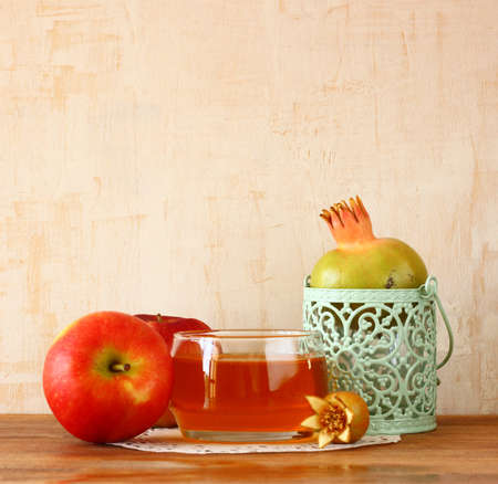 apple, honey and pomegranate symbols of rosh hashanah holiday photo