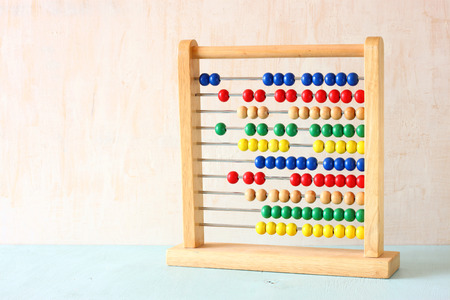 Beaded Abacus over wooden textured background   photo