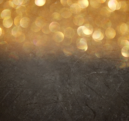 abstract bokeh lights over blackboard textured background   photo