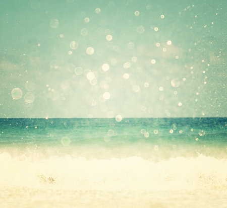 aqua background: background of blurred beach and sea waves with bokeh lights, vintage filter    Stock Photo