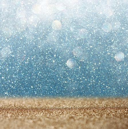 きらめきビンテージ背景ライトゴールド、デフォーカス青