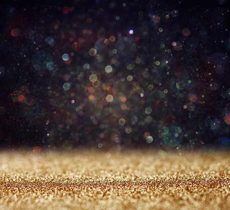 glitter vintage lights background  light gold and black  defocused   photo