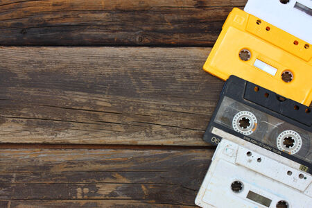 wooden table top view: Cassette tapes over wooden table  top view    Stock Photo