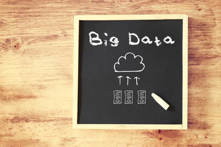 blackboard with the phrase big data over wooden board   photo