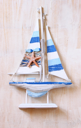 blue boat over wooden textured board   photo