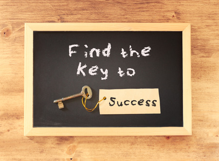 the phrase - find the key to success written on blackboard photo