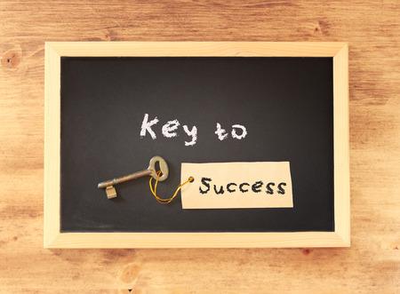 the phrase - key to success written on blackboard photo