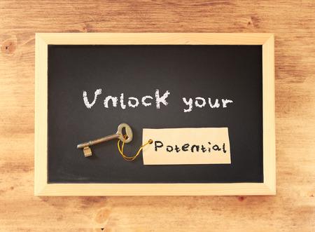 top view of blackboard with the phrase unlock your potential written on it    Foto de archivo