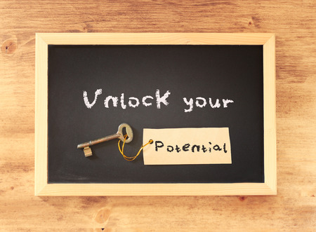 top view of blackboard with the phrase unlock your potential written on it    Banque d'images