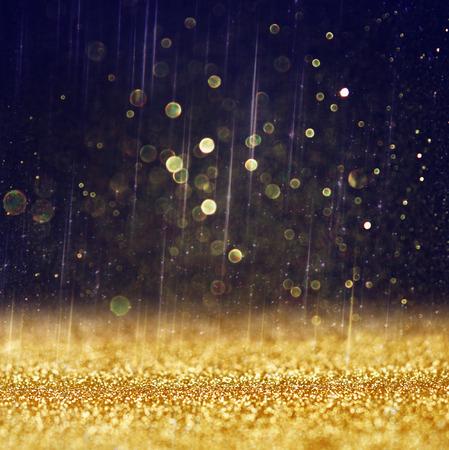 glitter vintage lights background  light gold and black  defocused    写真素材