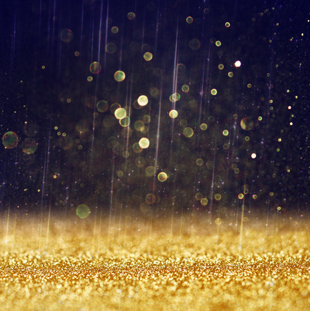 gold: glitter vintage lights background  light gold and black  defocused    Stock Photo