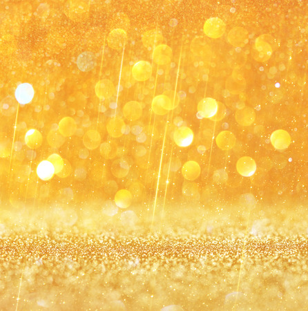 gold and warm abstract bokeh lights  defocused background   photo