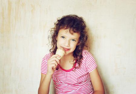 cute kid eating ice cream   filtered image   photo