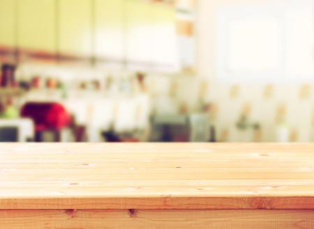 table decorations: empty table board and defocused retro kitchen background