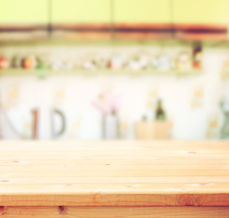 empty table board and defocused retro kitchen background photo