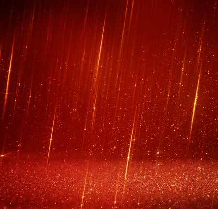 gold dust: red and gold abstract bokeh lights  defocused background