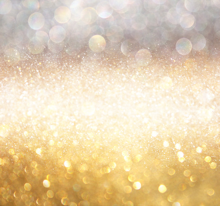 glittering: white silver and gold abstract bokeh lights. defocused background