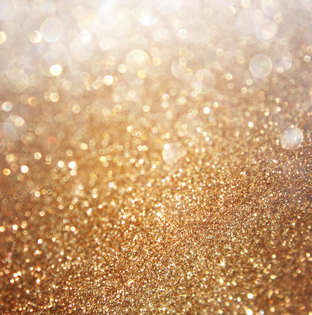 bling: Abstract gold background with copy space . gliiter bokeh lights