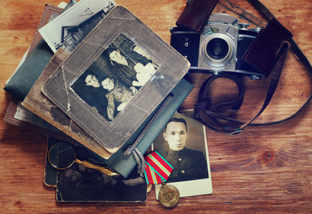 top view of vintage camera, old pictures and war madal. historic Stock Photo