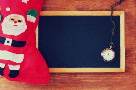 antiqued: top view of empty blackboard and red christmas sock
