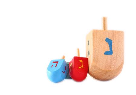 dreidels: Wooden dreidels for hanukkah isolated on white background.