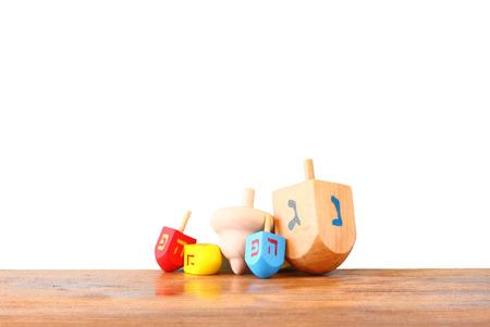 Wooden dreidels for hanukkah isolated on white background. photo