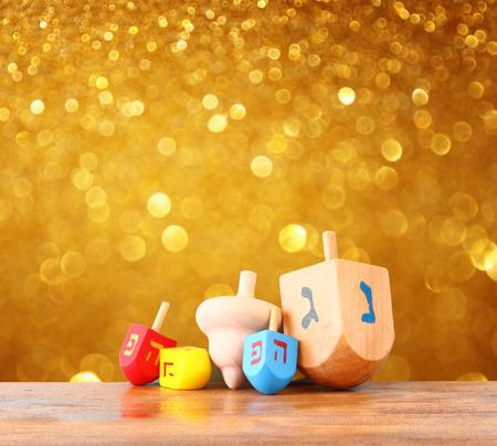 chanukah: wooden dreidels for hanukkah and glitter golden lights backgroun Stock Photo
