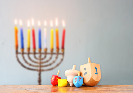 image of front woodwn table and menorah un the background.  photo