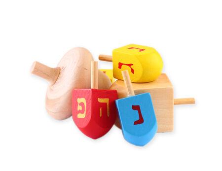 torah: wooden dreidels (spinning top) for hanukkah jewish holiday