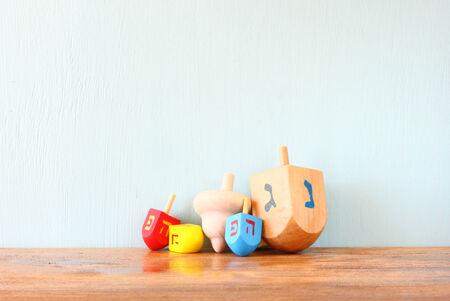 wooden dreidels for hanukkah (spinning top) over wooden background photo