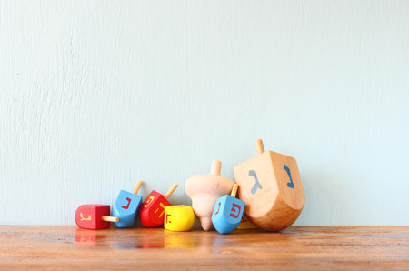 dreidel: wooden dreidels for hanukkah (spinning top) over wooden background