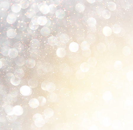 defocused: white silver and gold abstract bokeh lights. defocused background