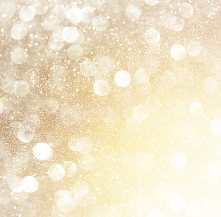 excite: white silver and gold abstract bokeh lights. defocused background