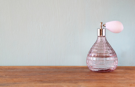Vintage antique perfume bottle, on wooden table Stock Photo