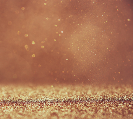 glitter vintage lights background. abstract gold background . defocused photo