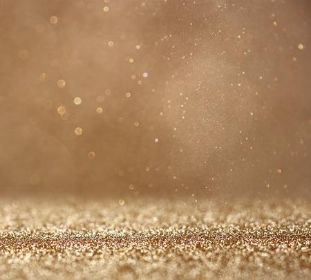 glitter vintage lights background. abstract gold background . defocused Standard-Bild