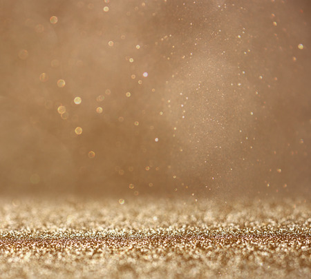 golden glow: glitter vintage lights background. abstract gold background . defocused Stock Photo