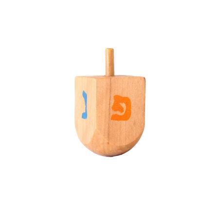 wooden dreidel (spinning top) for hanukkah jewish holiday photo
