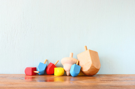wooden dreidels for hanukkah (spinning top) over wooden background photo