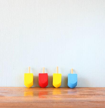 hanukka: wooden dreidels for hanukkah (spinning top) over wooden background