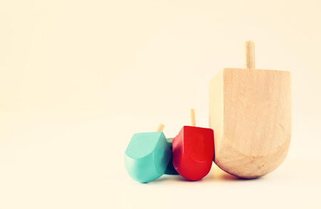 dreidel: wooden dreidels (spining top) for hanukkah jewish holiday . filtered image